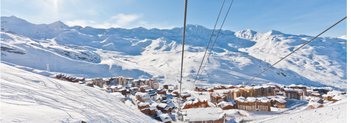Ski lift cables over snow slope in Val Thorens