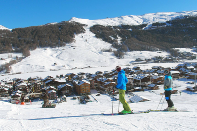 Village landscape and skier in Livigno, Italy