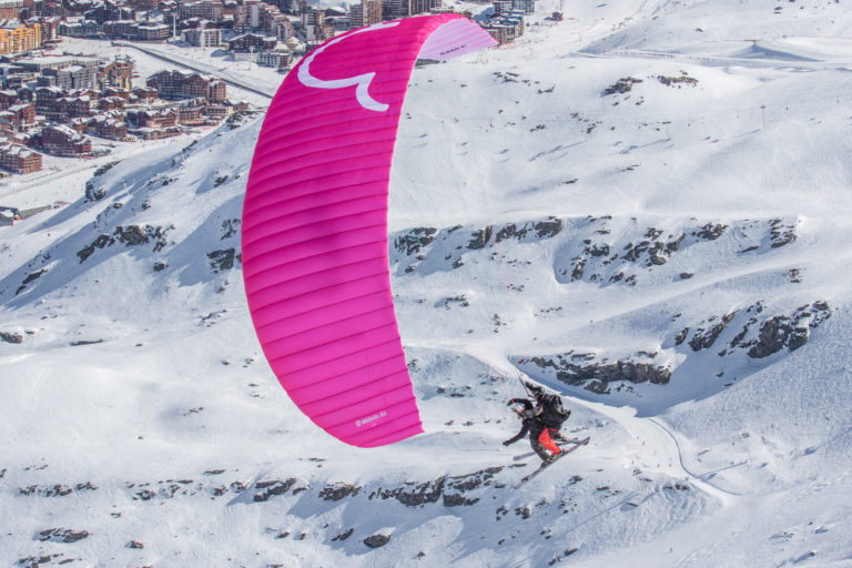 Paragliding on skis in the snow