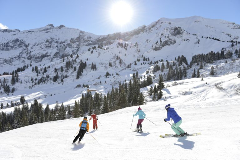 Four Alpine skiers on a slope