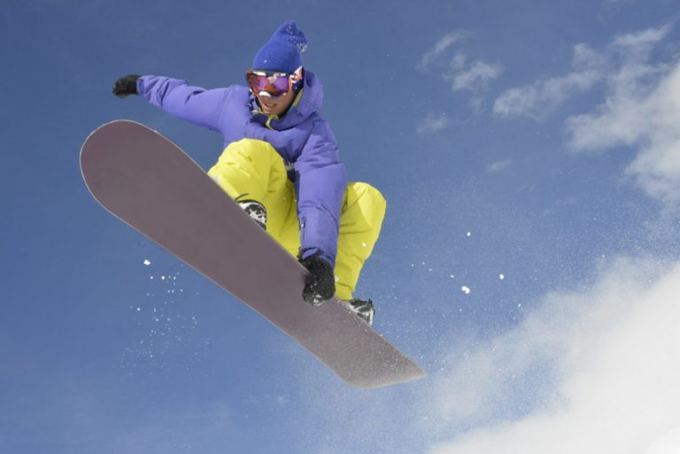 Snow boarder jumping through the air