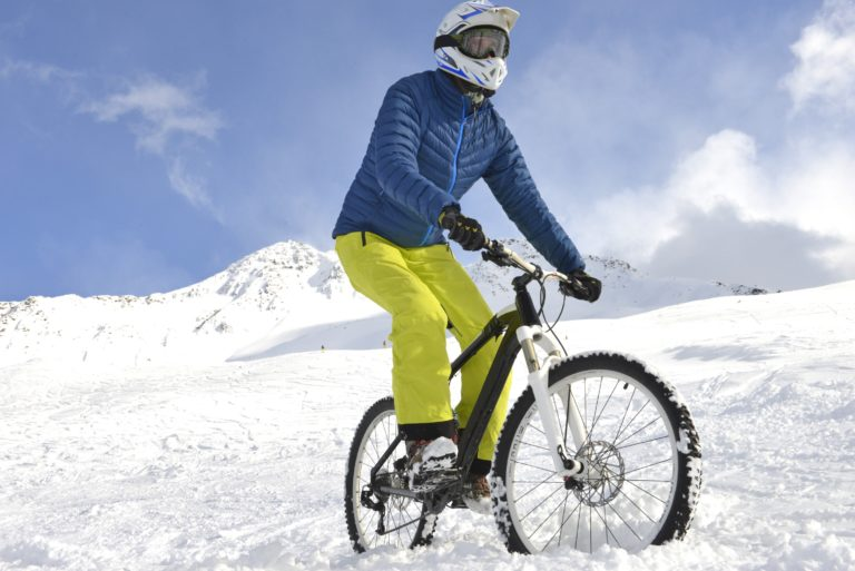 Mountain biker on snow
