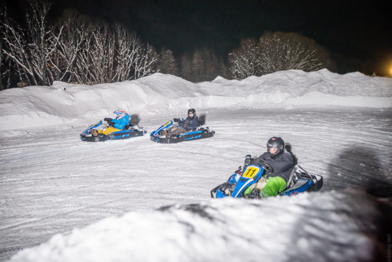 Three people go karting in the snow in Val d'Isere Ski Resort, France