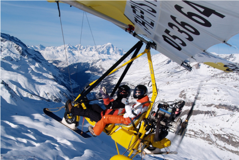 Two people in a microlight flying over Val d'Isere in France
