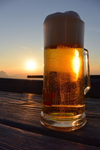 Beer in a glass in sunset
