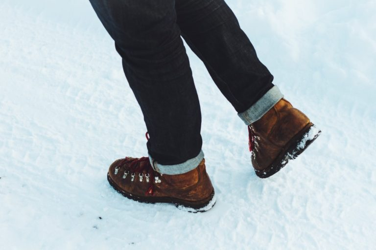 Brown boots with good tread on the snow