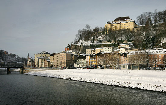Landscape of Salzburg with the river and snow cover edge