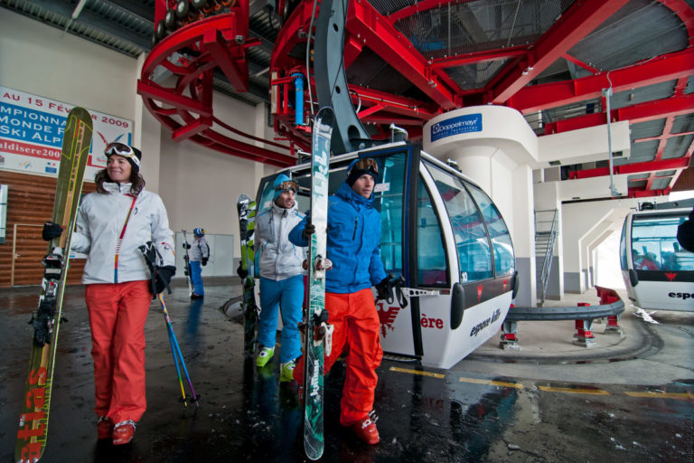 Skiers getting off gondola lift in Val d'Isere, France
