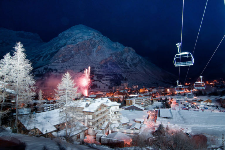 Nighttime landscape view of snowy Val d'Isere Ski Resort with lots of lights