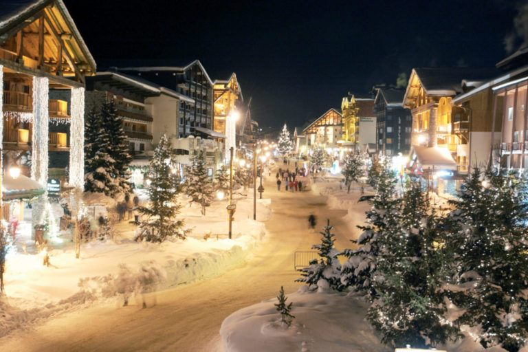 Nighttime view of snowy Val d'Isere Ski Resort with lots of lights