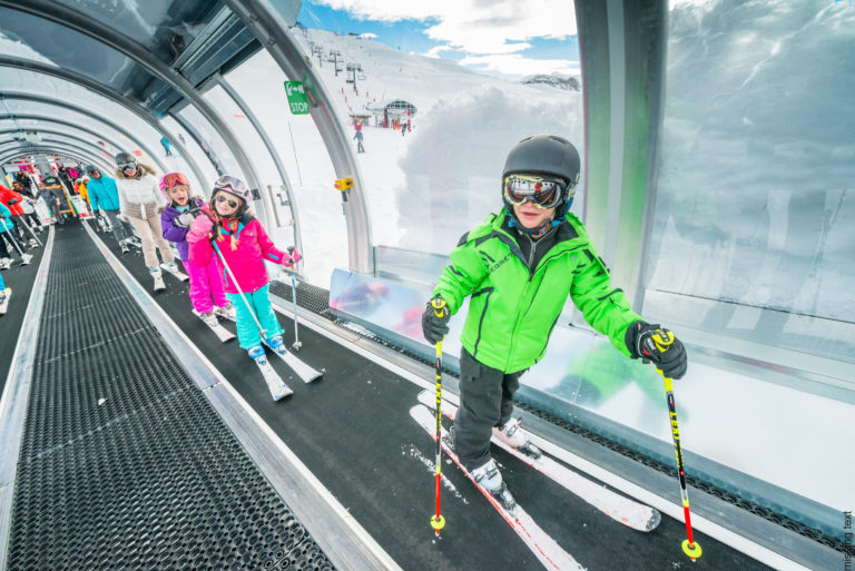 Kids on a ski carpet in Val d'Isere Ski Resort, France