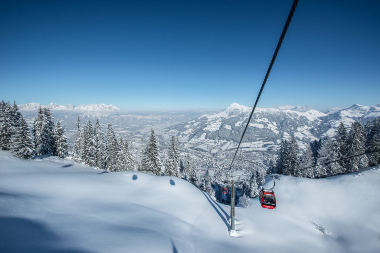 Gondola ski lift over snow covered mountain in Kitzbuhel or Kitzbühel, Austria