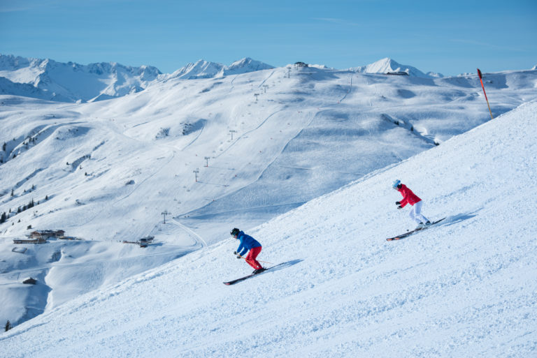 Alpine skiers in Kitzbuhel or Kitzbühel, Austria