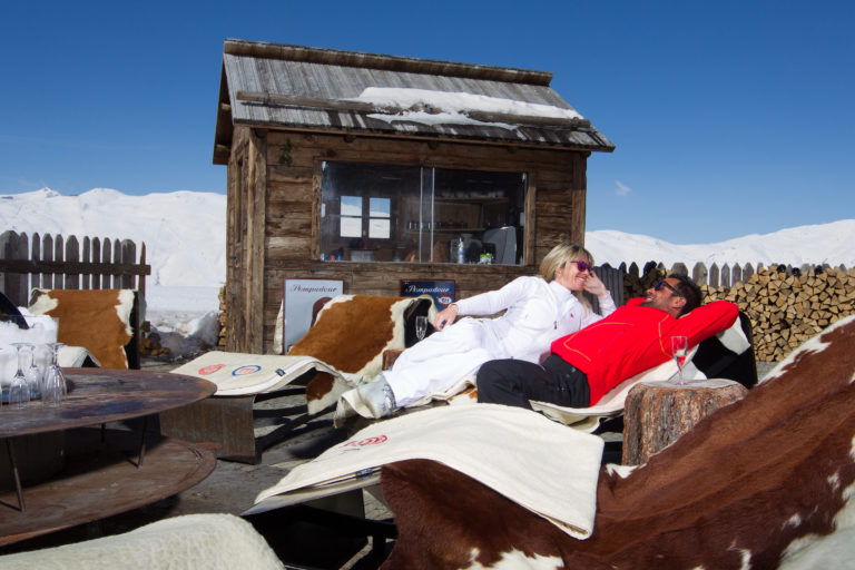 Resting in the sun after skiing on the slopes, Livigno Italy