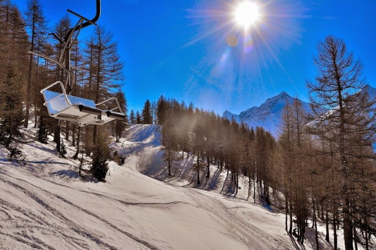 Chair lift over snow in Pragelato Vialattea Italy