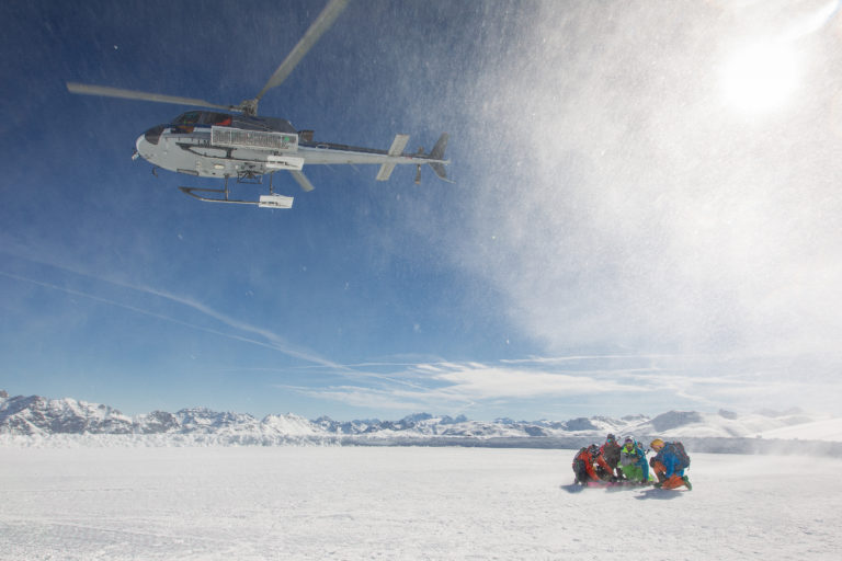 Heliski Helicopter over the snow at Livigno Ski Resort, Italy