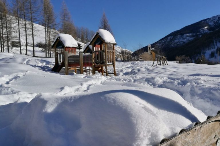 Children's playground covered in snow in Pragelato Vialattea Italy