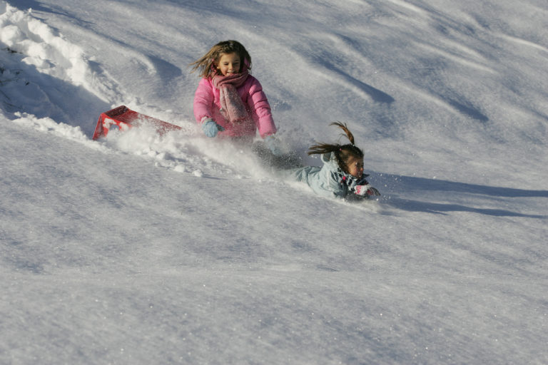 Children playing in the snow in Livigno Italy