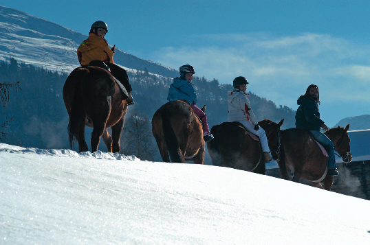 Horse riding in the snow in Livigno Italy