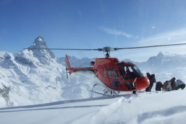 Helicopter for heli-skiing in the snow in Cervinia, Italy