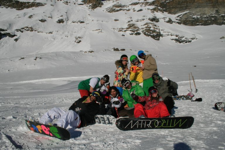 Friends snow boarding in the snow in Cervinia, Italy