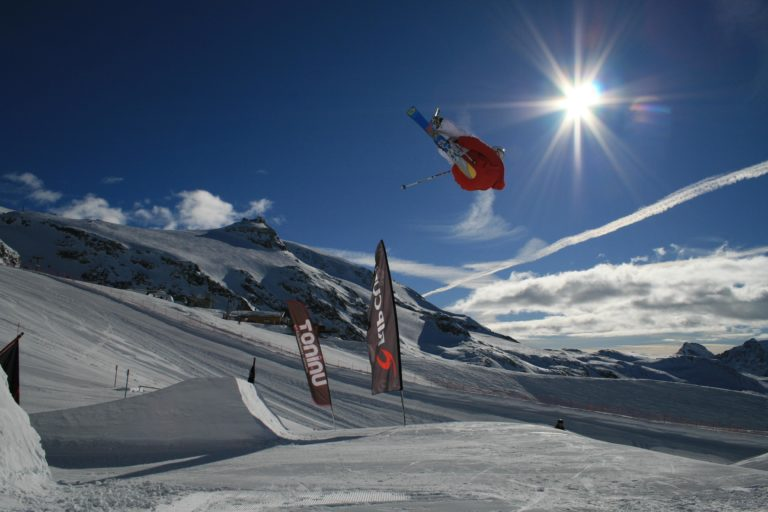 Advance skiers jumping over snow moguls in Cervinia, Italy
