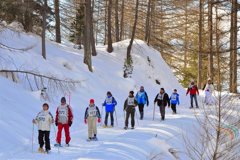 cross country walkers in snow shoes in Pragelato Vialattea Italy