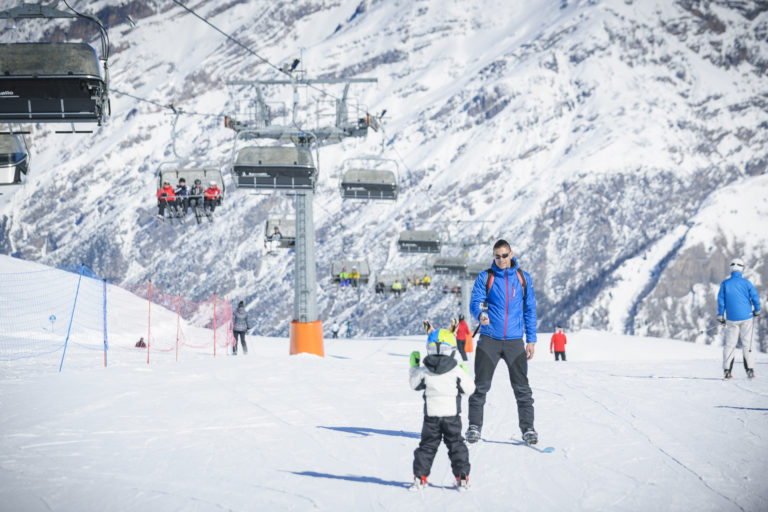 Family learning to ski in Livigno Italy