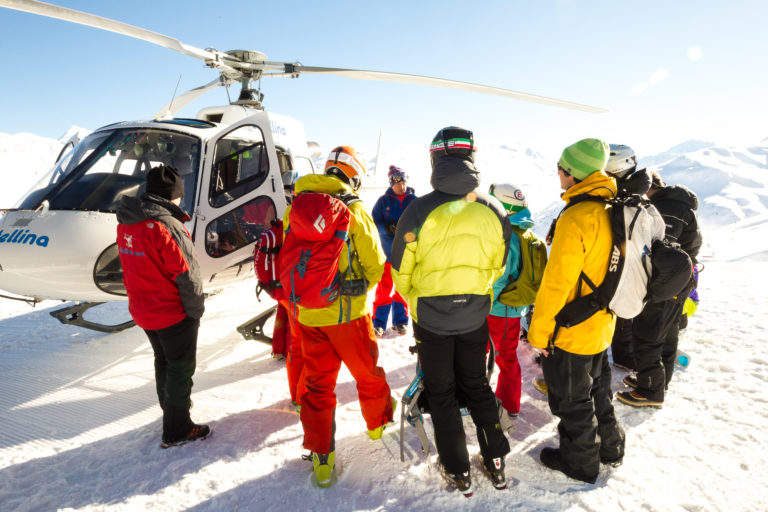 Adrenaline junkies getting on a helicopter to go heli-skiing in Livigno Italy