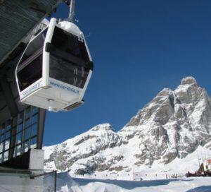 Ski lift gondola leaving the station