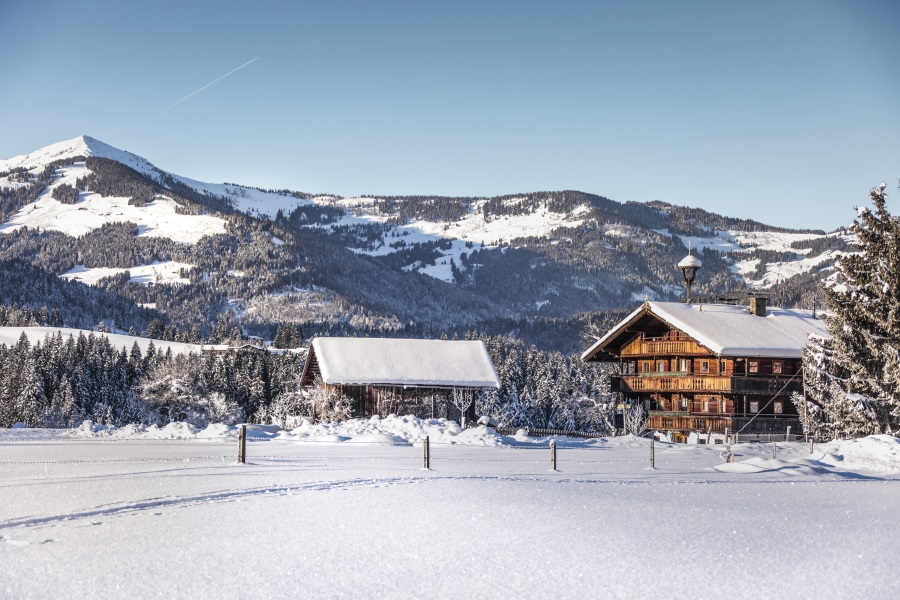 Tradtioneller-Hof covered in snow in Westendorf Austria