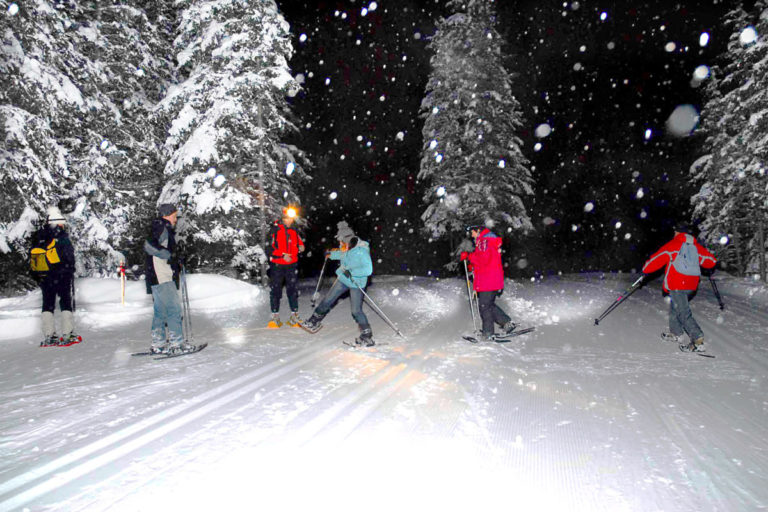 Night walk in snow shoes in Livigno Ski Resort, Italy