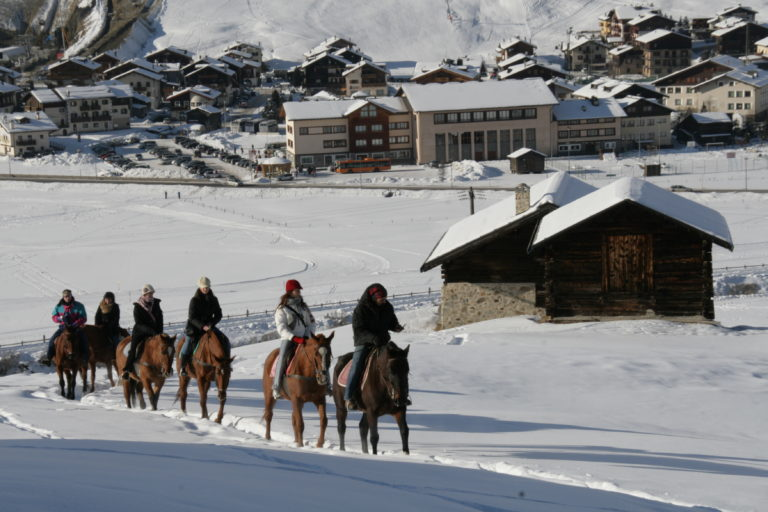 Horse back riders in the snow in Livigno Ski Resort, Italy