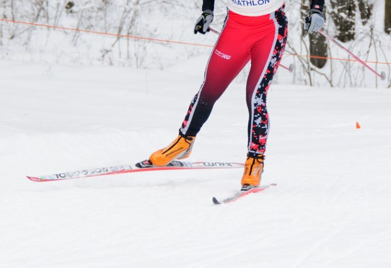 Cross country skier in skin tights red leggings